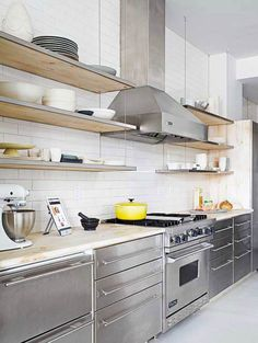 Stainless-steel cabinets are as contemporary as they are classic, bringing a balance of trendy and tried-and-true into this kitchen. A subtle… Stainless Steel Kitchen Cabinets, Modern Kitchen Cabinets, Kitchen Cabinet Colors, Kitchen Colors, Kitchen Interior, New Kitchen, Kitchen Decor, Kitchen Ideas, Cabinet Decor