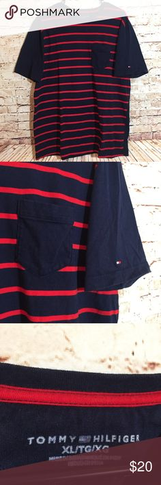 Tommy Hilfiger Blue Red Striped Shirt Logo on Arm Size XL extra large   Logo on arm.  100% Cotton.  Pocket on front.  Short sleeves.  Some light pilling.  Navy blue and red.  Solid blue back.    Flat Lay -->Bust 23 inches  -->Waist 22.5 inches  -->Length 29 inches Tommy Hilfiger Shirts Tees - Short Sleeve