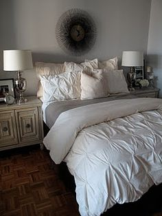 Circle piece above bed. Those lamps.