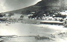 A view of Jubilee Square and Simon's Town from the sea, circa 1880. William Anderson's fishing shed is in the foreground.
