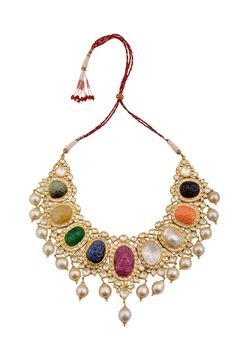 Amrapali's traditional Navratna (nine gem) necklace featuring eight carved gemstones and one large uncut diamond surrounded by diamonds and pearl drops.