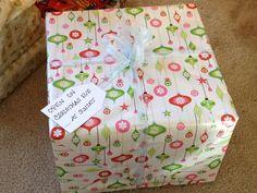 Christmas Eve Box -  Include: New pajamas, a Christmas movie, popcorn, mugs, hot chocolate, marshmallows, and a Christmas book.