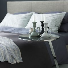 Calm bedroom with blue accents creates a contemporary masculine feel.