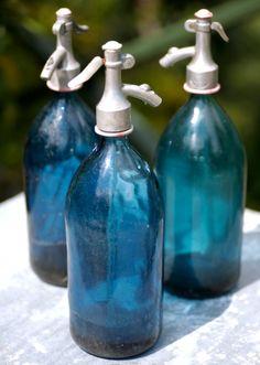 Blue glass vintage soda bottles from thebalconygardener.com
