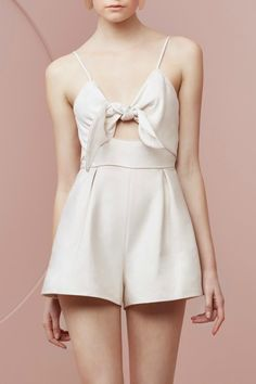 The Coming Home Playsuit Sand from keepsake. Centre back lapped zip. Fully lined. Soft semi-structured fabric. Inseam pockets. Piping along bodice. Fitted bodice. Tie front detail. Front waist cut-out detail. Adjustable straps.     Coming Home Romper by Keepsake. Clothing - Jumpsuits & Rompers - Rompers Miami, Florida