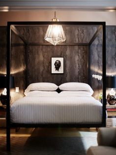 again. what a sexy bed. even better with that wall paper and chandelier