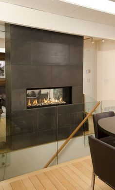 Solus Large panel concrete Tile installed around two sided fire place at stair well.