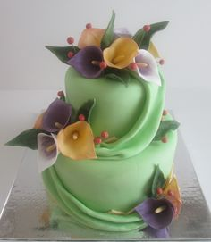 Cally Lily cake with fabric drapes  - All fondant with gum paste flowers.