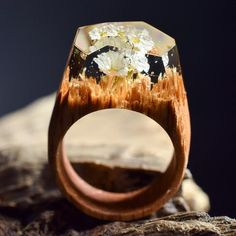 White flower forest - Handmade wooden rings with miniature mystery worlds inside them. Every ring is unique and one of a kind - made from finest fresh wood and jewellery resin!