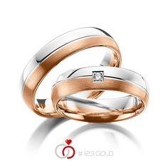 1 Paar Trauringe - Legierung: Weißgold 585/- Rotgold 585/- Breite: 5,50 - Höhe: 1,50 - Steinbesatz: 1 Brillant 0,03 ct. tw, si (Ring 1 mit Steinbesatz, Ring 2 Trauringe Steinbesatz)