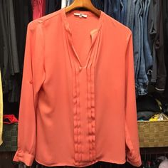 Mango blouse Loose fit with great flow to the fabric.  Good with a skirt or jeans.  Can dress up or down. Tops Blouses