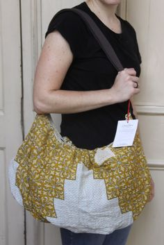 """""""How many bags do you usually take on an out-of-state or overseas trip?"""" Leave a comment before November 7th and this beautiful handmade cloth bag from India could appear in your mailbox!    Beautiful Ideas Help the World: ASIA  Sari Bari Hobo Bag Giveaway"""