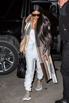 Kim Kardashian wearing Hermes 35cm Birkin Bag in Black Croc, Yves Saint Laurent Sl 1/S 59/13/140 Sunglasses and Adidas x Kanye West Yeezy 350 Boost Sneakers in Turtle/Dove Grey
