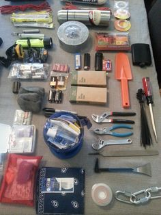 Basic requirements for survival - multiple scrape/burn/basic dressing first-aid packs, more comprehensive suture/syringe kit with scalpels and wound stapler in GSI Outdoor Fairshare Mug (multiple use), Wet tinder fire started with Blastmatch, lighters, 9V Battery with fine steelwool and magnesium/flint fire-starter. Hot water thermos to extend fuel usage and minimize waste, small shovel and thermal survival bivi, flask and light