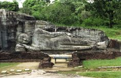 Reclining Buddha at Gal Vihara, Polonnaruwa, Sri Lanka.  Polonnaruwa was the second capital of Sri Lanka following the destruction of Anuradhapura in 993. Within Polonnaruwa is one of the largest sculptures in Southeast Asia: the reclining Buddha, which measures 14 metres long.