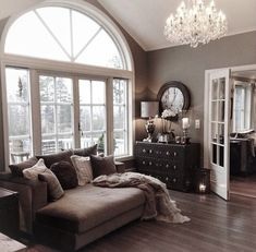Cozy living room in grays..I could live without the gray however I LOVE the window and french doors!