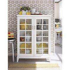 About Us I need this cabinet in a dark espresso colour for my dining room! Paterson White Two-Door Cabinet, Spin Counter Stool, Harper Rug - Gray Espresso Kitchen Cabinets Storage Cabinets, Kitchen Storage, Kitchen Display, Bath Storage, Kitchen Cupboard, Toy Storage, Extra Storage, White Cabinets, Glass Cabinets