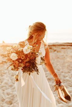 Free flowing in this gorgeous chiffon gown by Jenny Yoo, exclusively available via BHLDN. This sleeveless gown features a plunging v-neckline that leads to an airy A-line skirt gently gathered at the waist; covered buttons accent the illusion back. This wedding dress is perfect for the beach wedding babe looking to be free-spirited, youthful and romantic on her big day! Photo by @alexandriamonette