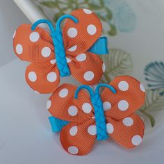 Orange and Bright Blue Polka Dot Butterfly Bows- Ribbon Sculpture Hair Clips. $9.00, via Etsy. These are the BEST bows on Etsy :-)