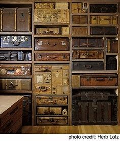 great storage and decorating idea - take a photo and label what's inside each trunk or suitcase.