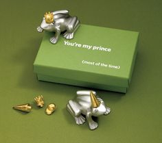Vilmain Pewter - Frog Prince Paperweight He's your prince, most of the time. This cute frog comes with four different hats, a gold plated crown, ball cap, cowboy hat and dunce cap. Move them around to