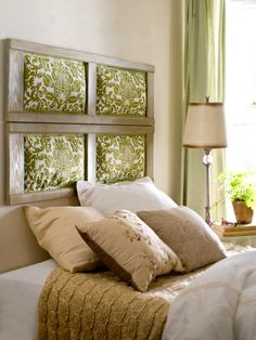 Try re-using old windows for a funky new headboard. Either keep the original glass panes, or try this twist with fabric and batting.