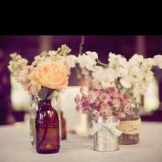 Rustic, vintage centerpieces; I love the soup cans, add lace and/or burlap, and viola!
