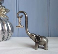 Silver Pewter Elephant Ring Stand - jewellery storage & trinket boxes. This would be a fun woodcarving project.