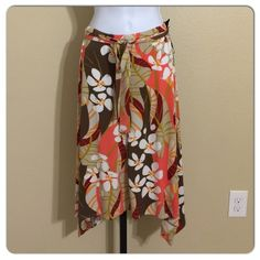 Skye's Island Hopping Skirt Size S Skyes The Limit Women's Skirt Size S Orange, Brown, Pink, Beige & White  Floral Pattern Pull On Style AsymmetricalHem Waist Sash Tie Machine Washable 95% Polyester 5% Spandex Waist With Fully Relaxed Waistband Approx. 30 Inches Waist Will Comfortably Stretch To Approx. 32-35 Inches Hips Approx. 38 Inches Front Length Approx. 23.5 Inches Rear Length Approx. 24 Inches MSRP $ 49.00 New With tags Skye's The Limit Skirts