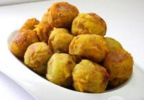 Guyanese Potato Balls-A savory mixture of mashed potatoes rolled into balls, battered and deep fried.