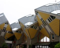 Living in a tilted house is much easier than it looks—just ask the people living in these the Kijk-Kubus cube homes. Architect Piet Blom tipped a conventional house forty-five degrees and rested it upon a hexagon-shaped pole so that three sides face down and the other three face the sky. Each of the cube houses accommodates three floors: a living space including a kitchen, study and bathroom, the middle floor houses bedrooms and the top is the pyramid room that can act like an attic or…
