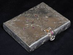 CONTINENTAL .800 SILVER COMPACT possibly Boucheron, encrusted with semi-precious stones