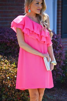 """Go shawty, it's """"sherbet"""" day! You'll feel like the center of attention in this bright and bold dress. It has a feminine ruffled top and chic one shoulder fit. Dress is lined and has a silicon strip to hold it in place."""