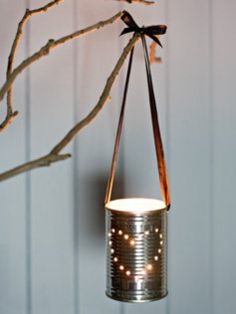 Punched tin cans hanging from a centerpiece.  Esp at a barn or country reception.  Ginham ribbon or twine?