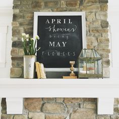 Spring farmhouse mantel combines a fun chalkboard/quote for graphic appeal with a few rustic touches for a simple focal point to the room. Interior design & chalk art by Janna Allbritton of Yellow Prairie Interior Design.