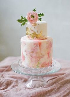 Prettiest pink on white marble cake ever! Love the gold leaf detail on the cake and the flower topper.