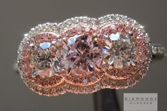 halo three stone diamond ring