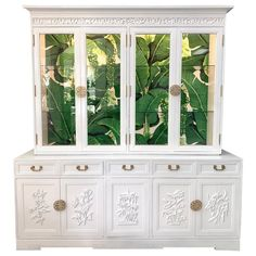 Asian Style lighted china hutch by Ricardo Lynn finished in high gloss white lacquer and Dorothy Draper Brazilliance wallpaper. Features brass hardware and ample storage. Excellent vintage condition with minor imperfections to the newly lacquered finish. Chalk Paint Colors, White Chalk Paint, Chalk Paint Hutch, Hollywood Regency, Annie Sloan, Painted China Cabinets, Chinese Cabinet, China Cabinet Display, Display Cabinets
