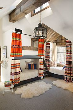 Only the most beautiful, rustic, luxurious bunk room bedroom with Pendleton blanket curtains and sheepskins at a vacation house in Aspen featured in AD, with interior design by Bonesteel Trout Hall