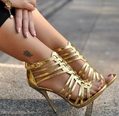 In love with these strapy, gold stilettos.