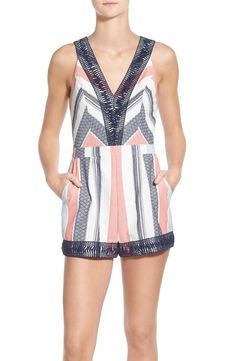 This red, white and blue romper puts a contemporary spin on a nautical look.