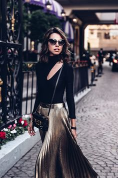 Black turtleneck body suit with cut out + gold pleated midi skirt