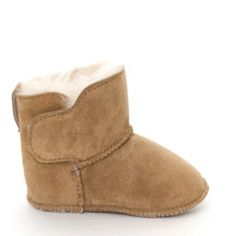 australian sheepskin baby booties....she has to be stylish tooooo ;)  This is good when the floors are cold, but she doesn't want to wear her shoes