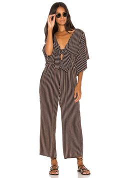 1351b69e7e2 25 Fall Jumpsuits You Need in Your Closet Now