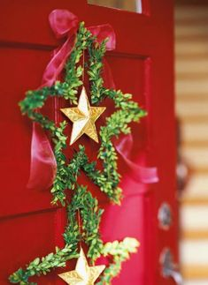 Bend thin-gauge wire into stars and attach boxwood sprigs to the stars with florist wire. More holiday wreaths: http://www.midwestliving.com/homes/seasonal-decorating/beautiful-holiday-wreaths/?page=5,0