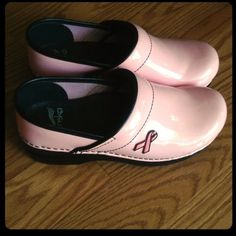 Pink Dansko Clogs (Lmtd Edtn Brst Cncr Awrnss) The Dansko Brand is at the top of its game with durable long lasting clogs used in work settings such as nursing, kitchen/restaurant work,  or even recreational wear. These clogs are worn a couple times, but grips look brand new. Minor scuffs pictured. These are my mom's for work but they were too small. Runs small, size 7, will fit a 5 1/2 - 6. Dansko Shoes Mules & Clogs