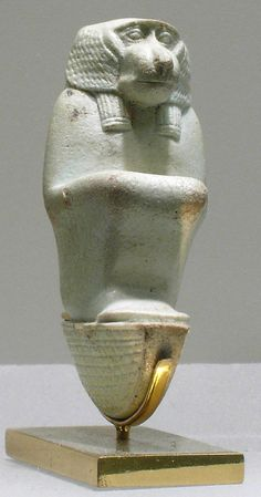 Figure of baboon on a basket and with a pillar, the shebet offering  Period: Late Period Dynasty: Dynasty 26–30 Date: 664–332 B.C. Geography: Egypt