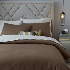 NEW! Made of 100% woven and then over dyed cotton, our Jacquard Diamond Duvet Cover + Shams add texture to your bed with a raised, all-over diamond pattern.