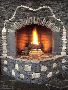 fireplace by Lew French, Stone Master; can't say for sure but angles of rear firebox walls look close to a Rumford, maybe a bit deeper, not as high as some. Experts?