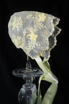 A lovely lemon yellow embroidered bonnet is a stand out in our Spring line. This sheer bonnet features a delicate scallop edge that frames the face. Tiny yellow flowers with pearl centers were added to the crown and to the ribbons that tie under her chin. The bonnet will ship within 5 business days after order is placed. Please select a size during checkout so that we can provide you with a properly fitted bonnet. In the note to Seller during checkout please include the date you need the…